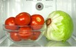 Open refrigerator with vegetable and temerature sensor