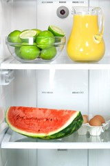 Open refrigerator with healthy food