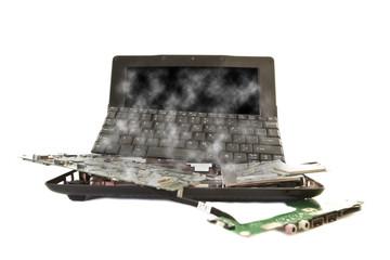 damaged computer broken into parts