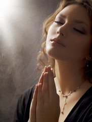 Praying Woman. Retro Styled. Soft focus