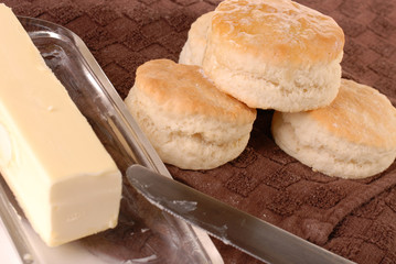 Homemade baked biscuits dripping with butter