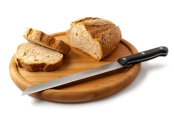 Sliced cereal bread and knife