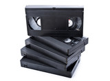 Stack of black old video cassettes