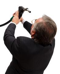 Man looking into gas nozzle