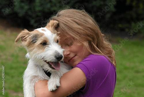 Leinwanddruck Bild Kind mit Hund
