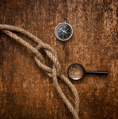 compass, magnifying glass and rope