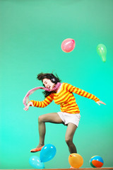 Jumping happy girl with balloons