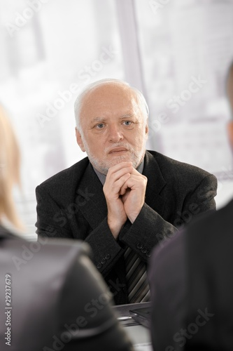Experienced businessman concentrating