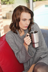Young woman holding cup