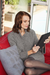 Young woman using iPad