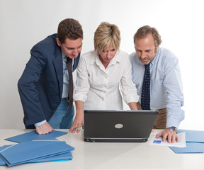 Business colleagues watching laptop