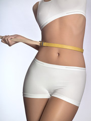 Young woman in underwear tightening belt