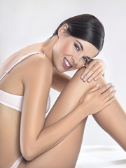 Young woman in underwear smiling for camera