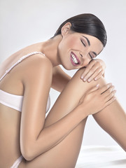 Young woman in underwear smiling