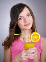 adorable girl with a glass of orange juice