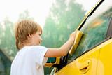 Little boy washing car. Summer. Sunset - 29246278