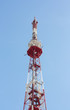 Tele communication tower over blue cloudless sky