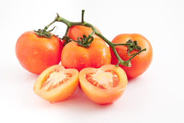 Bunch of vine tomatoes on white