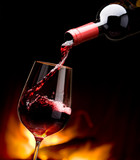 pouring wine by the fireplace - 29249432
