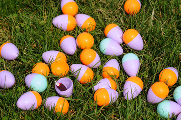 Cluster of plastic Easter eggs with opened one showing candy