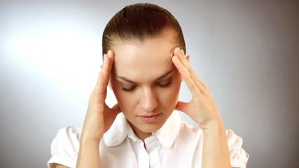 Woman having headache, grey background
