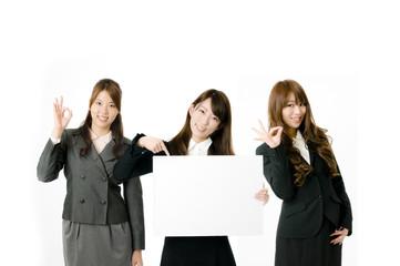 メッセージボードと女性社員