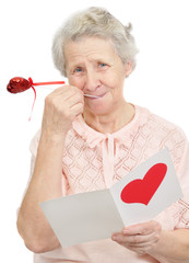 senior woman hold post-card with heart shape on it cover