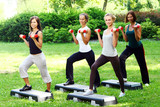 Fototapety Young and attractive womans doing fitness exercises