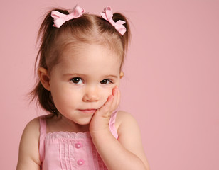 Cute toddler girl posing on pink