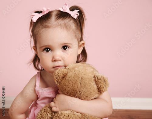 Beautiful girl and teddy bear