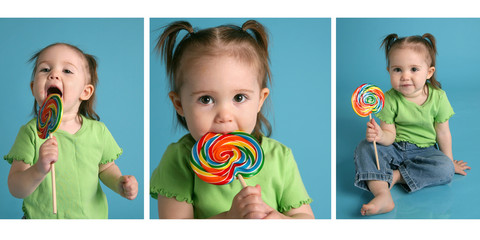 Cute baby eating a lollipop treat