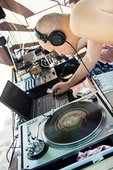 Disc jockey playing the record