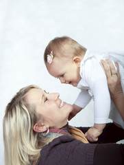 beautiful mother with her baby girl