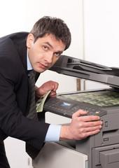 Businessman make false money on copy machine