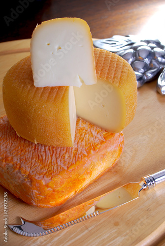 French orange rind cheese on a wooden sheese board