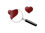 Magnifying glass with hearts, symbolizing the search for love