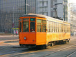 Old orange tram in Milan, Italy