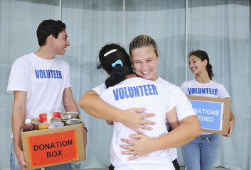 volunteer group with food donation boxes