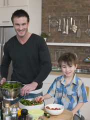 Father and Son Preparing Salad