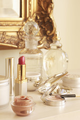 Table With lipstick and other Cosmetics and Wall Mirror
