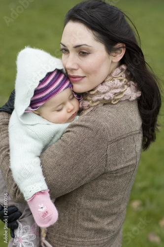 Mother with baby sleeping in her arms