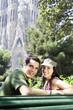 Spain, Barcelona, Sagrada Familia, young couple enjoying view, portrait