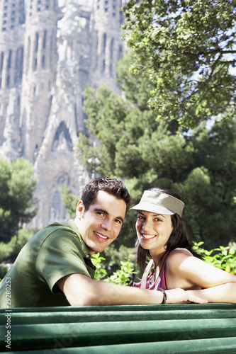 Spain, Barcelona, Sagrada Familia, young couple enjoying view, portrait