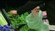 Woman Selecting Green Beans In Produce