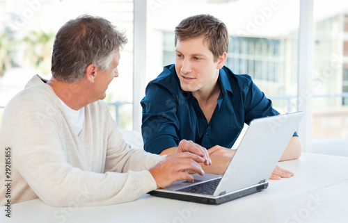 Two businessman working on their laptop