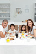 Family having breakfast in the kitchen