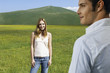 Couple in mountain Meadow, woman looking at man