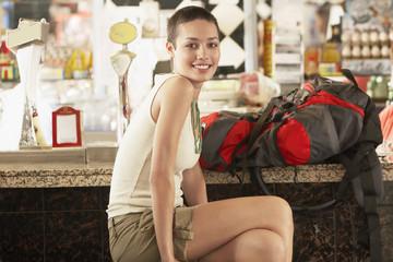 Female hiker sitting in bar, portrait