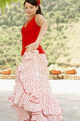 Woman flamenco dancing outdoors.