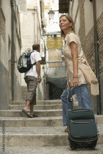 Woman with Luggage in Alley
